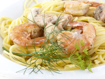 Spaghetti wiht shrimps. Portion of spaghetti with shrimps decorated with some herbs Royalty Free Stock Photos