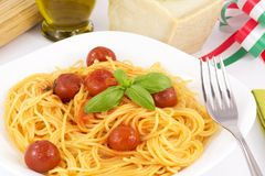 Spaghetti wiith tomato e basil. Traditional Italian dish, spaghetti with Italian Royalty Free Stock Image
