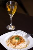 Spaghetti and wine on table Royalty Free Stock Photos