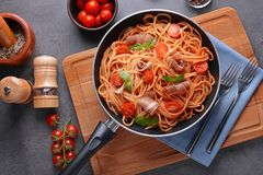 Free Spaghetti With Amatriciana Sauce And Bacon In Pan, Stock Image - 105733261