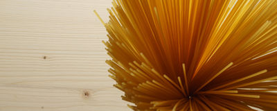 Spaghetti on wooden background - banner / header edition Stock Photography