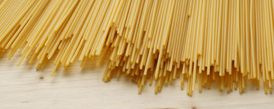 Spaghetti on wooden background - banner / header edition Royalty Free Stock Image