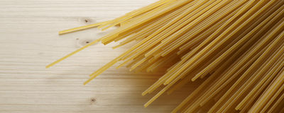 Spaghetti on wooden background - banner / header edition. Pasta  on wooden background - banner / header edition Royalty Free Stock Photo