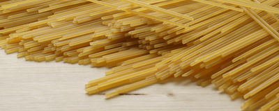 Spaghetti on wooden background - banner / header edition Royalty Free Stock Photos