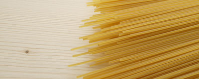 Spaghetti on wooden background - banner / header edition. Pasta  on wooden background - banner / header edition Royalty Free Stock Images