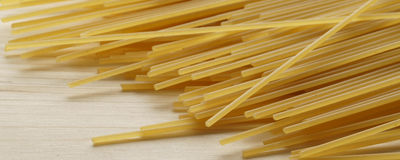 Spaghetti on wooden background - banner / header edition Stock Photo