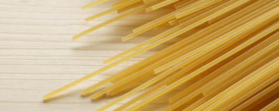 Spaghetti on wooden background - banner / header edition Royalty Free Stock Images