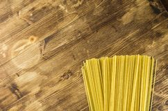 Spaghetti on a wooden background. Top view Royalty Free Stock Photos