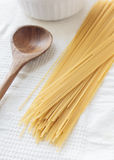 Spaghetti and wooden spoon Royalty Free Stock Images