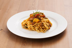 Spaghetti_2013-1. Spaghetti on a wooden table Stock Photography