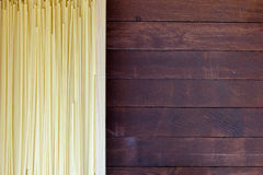 Spaghetti on wooden table Royalty Free Stock Photos