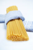 Spaghetti wrapped in cloth Stock Images