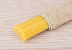 Spaghetti wrapped in coarse burlap Royalty Free Stock Image