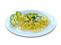 Spaghetti Zucchine. Delicious Italian spaghetti with zucchini. On white background for restaurants, menu and food industries. Pasta for Mediterranean diet. Front Stock Images