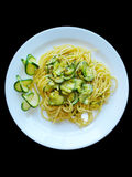 Spaghetti Zucchini. Delicious Italian spaghetti with zucchini. On black background for restaurants, menu and food industries. Pasta for Mediterranean diet. Top Royalty Free Stock Photography
