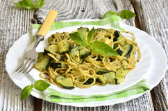 Spaghetti with zucchini and basil pesto. Stock Photo
