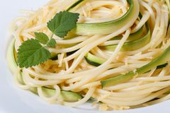 Spaghetti with zucchini and mint on a plate macro horizontal Stock Photography