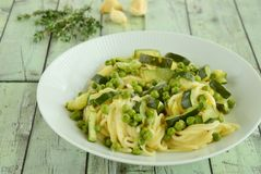 Spaghetti with zucchini and peas. Seasoned with rosemary and garlic Stock Photos