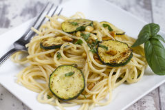 Spaghetti with zucchini and pine nuts Stock Image