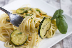 Spaghetti with zucchini and pine nuts Royalty Free Stock Image