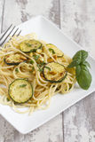 Spaghetti with zucchini and pine nuts Royalty Free Stock Photography