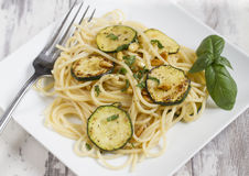 Spaghetti with zucchini and pine nuts Stock Photo