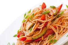 Spaghetti with zucchini and tomato Stock Photos