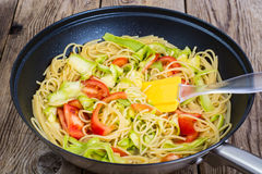 Spaghetti with zucchini and tomatoes Stock Images