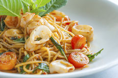 Spaghetties Spicy Seafood with Sweet Basil. Close up spaghetties Spicy Seafood with Sweet Basil Stock Photos