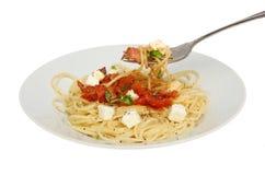 Spaghettis überziehen und gabeln Stockfotografie