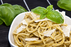 Spaghettis in a bowl on a black tablecloth Stock Photography