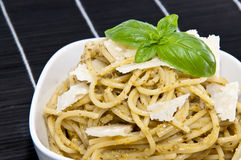 Spaghettis in a bowl on a black tablecloth Stock Images