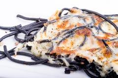 Spaghettis mit gebackenem Käse Stockbild
