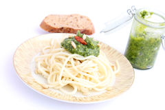 Spaghettis with pesto Stock Photos