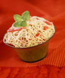 Spaghettis with red peppers and basil Stock Image