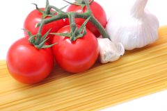 Spaghettis, tomatoes and onions Stock Photos