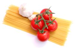 Spaghettis, tomatoes and onions Stock Photo