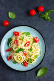 Spaghetty pasta  with cherry tomatoes,  basil and parmesan chees Royalty Free Stock Photos