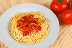 Spahgetti. A plate with spaghetti and tomato sauce Royalty Free Stock Photo