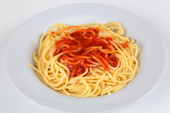 Spahgetti. A plate with spaghetti and tomato sauce Royalty Free Stock Photos