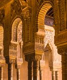Spain, Andalusia, Alhambra, Moorish, intricate carved columns and capitals, arches. Spain, Granada, Alhambra, columns and colonnades crafted in decorative wood royalty free stock image