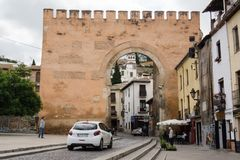 Granada city wall gate arch royalty free stock photo