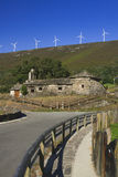 Spain, Asturias, Wind Turbines and Ancient Church Royalty Free Stock Images