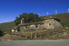 Spain, Asturias, Wind Turbines and Ancient Church Royalty Free Stock Photos