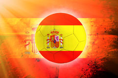 Spain ball. Soccer ball with Spain flag as the background Royalty Free Stock Photo
