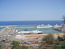 Spain, Barcelona, August 21, 2008. The main port of Barcelona. L. Arge liners and ships stand against the blue sea royalty free stock photo