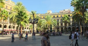 BARCELONA, SPAIN, MAY 22, 2017: Barcelona Plaza Real, famous square with fountain and palms. SPAIN BARCELONA JULY 2017: Barcelona Plaza Real, famous square with stock footage