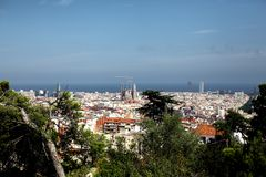 Spain, Barcelona - July 12 2018 : Top-view of skyline at sunny day from high point in park GUEL.View of the construction royalty free stock image
