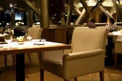 Spain, Barselona - November 19, 2013. Uma restaurant.  design in the evening. Spain, Barselona - November 19, 2013. Uma restaurant.  design and table Stock Images