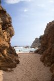 Spain beach behind high rocks Stock Photography